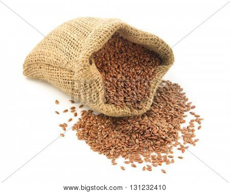 flax seeds in bag isolated on white background