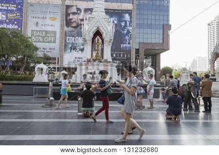 BANGKOK THAILAND - APR 17 : scene of tourist walking in Trimurati shrine at Central world in Ratchaprasong area on april 17 2016. Thailand. Trimurati shrine is one of sacred item in Ratchaprasong area