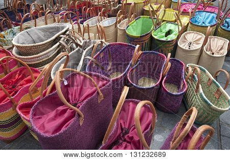 Colorful woven baskets on the market in the street