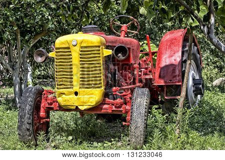 Old red tractor on a farm on the island of Crete