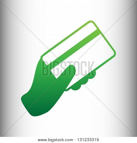 Hand holding a credit card. Green gradient icon on gray gradient backround.