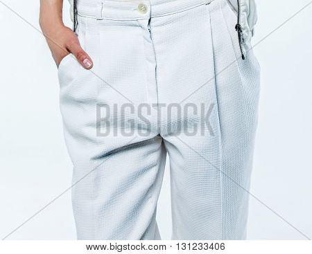 Body part of the woman in fashionable trousers