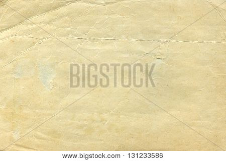 Vintage old worn paper blank background. Closeup