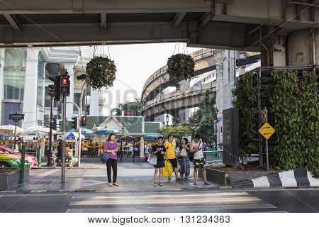 BANGKOK THAILAND - APR 17 : unidentified people wait for walk across crosswalk near Erawan shrine at Ratchaprasong Junction on april 17 2016 thailand. Ratchaprasong Junction one of is famous landmark of Bangkok