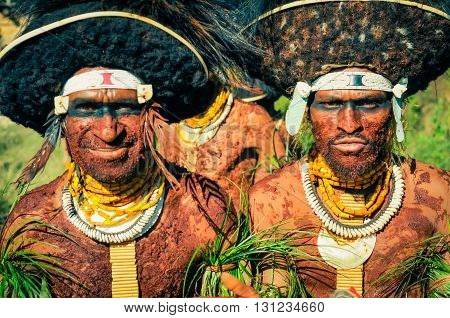 Opposite Faces In Papua New Guinea