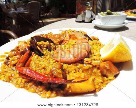 Spanish Paella, restaurant scene with paella plate