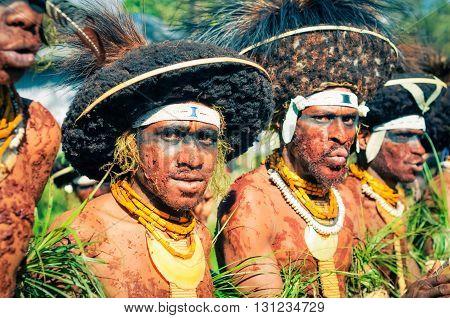 Men Covered In Mud In Papua New Guinea