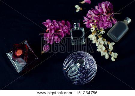 different  female perfume bottles in black background