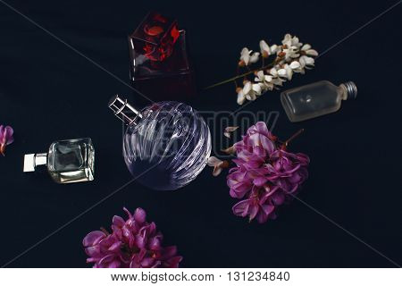 different female perfume bottles in black background