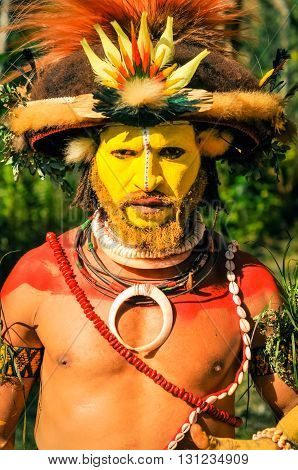 Man With Red Shoulders In Papua New Guinea