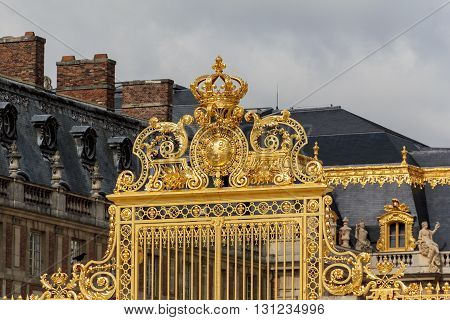 Versailles, France - May 12, 2013: This is coat of arms and crown on a gate in the ex-royal residence Palace Versailles.
