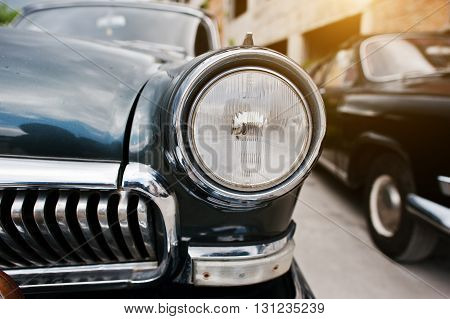 Close up old vintage car headlight classic