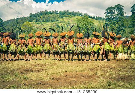 Long Row Of Men In Papua New Guinea