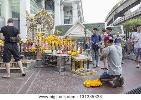BANGKOK THAILAND - APR 17 : Unidentified tourist pray to Erawan shrine at Ratchaprasong Junction on april 17 2016 Thailand. Erawan shrine is one of famously sacred item in Ratchaprasong area