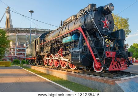 MOSCOW - MAY 11 2016: the Real Old steam locomotive near the stadium Lokomotiv Moscow. Symbol Sports Society Locomotive
