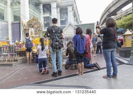 BANGKOK THAILAND - APR 17 : group of tourist worship in Erawan shrine at Ratchaprasong Junction on april 17 2016 Thailand. Erawan shrine is one of famously sacred item in Ratchaprasong area