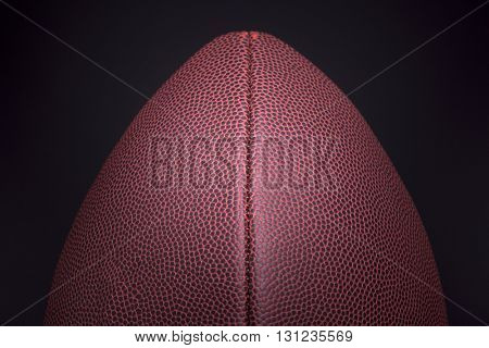 Rugby ball on black background