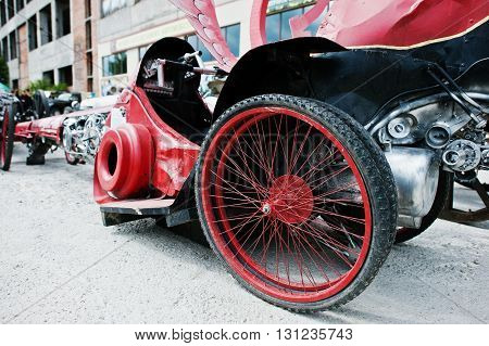 Spare wheels at handmade red sport car
