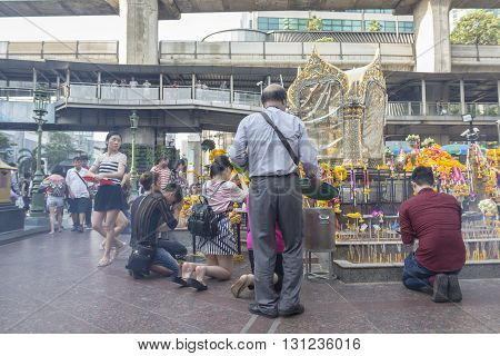 BANGKOK THAILAND - APR 17 : mass of tourist worship in Erawan shrine at Ratchaprasong Junction on april 17 2016 Thailand. Erawan shrine is one of famously sacred item in Ratchaprasong area