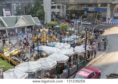 BANGKOK THAILAND - APR 17 : Unidentified crowd in Erawan shrine at Ratchaprasong Junction on april 17 2016 Thailand. Erawan shrine is popular place in Ratchaprasong area