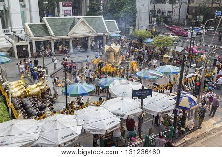 BANGKOK THAILAND - APR 17 : mass of Unidentified people worship in Erawan shrine at Ratchaprasong Junction on april 17 2016 Thailand. Erawan shrine is popular place in Ratchaprasong area