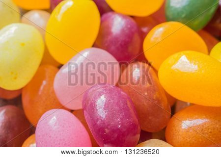 Closeup on mix of jelly beans colorful background. Macro image shallow depth of field