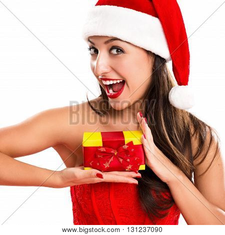 Portrait of a beautiful cheerful woman dressed as Santa with a gift in their hands
