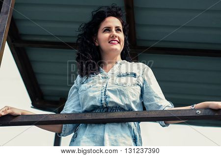 Pretty young woman enjoying the view of beach.