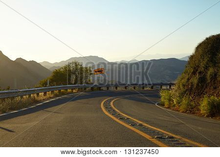 Road through the hills in Malibu at sunset California
