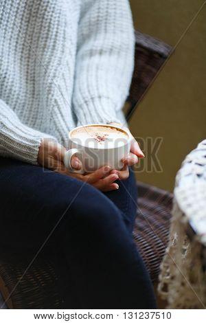 Cup Of Cofee In Woman Hands Closeup
