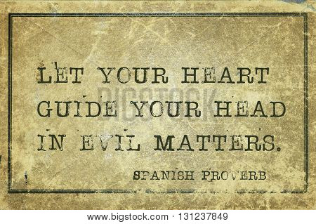 Let your heart guide your head - ancient Spanish proverb printed on grunge vintage cardboard