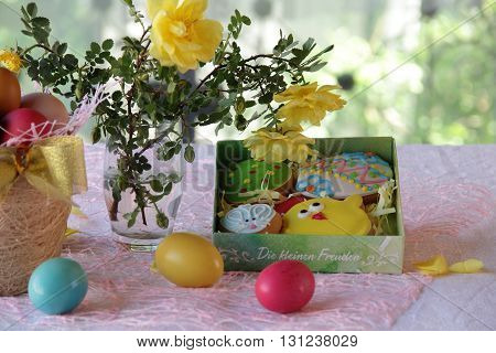 Easter cookies in a box and Easter eggs in a basket