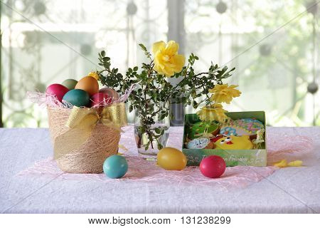 Easter still life with painted eggs and Easter biscuits