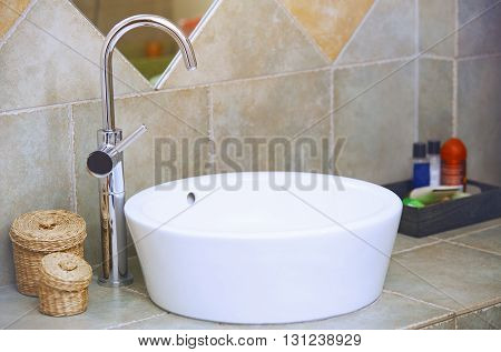 Water tap and sink in domestic bathroom