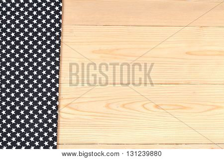 Color tablecloth on brown wood table background