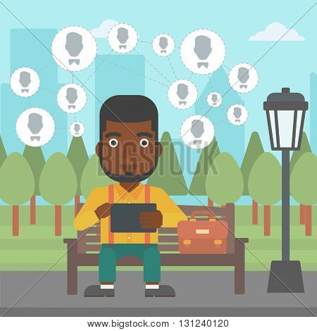 An african-american man sitting on a bench in the park and holding a tablet computer with many avatar icons above vector flat design illustration. Square layout.