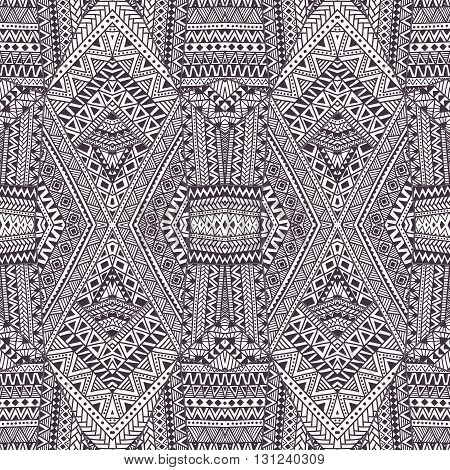 Seamless geometric pattern. Gray and white ornament. Vector illustration. Ethnic and tribal motifs.