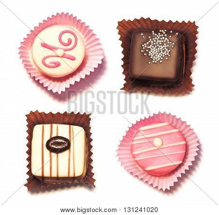 Petit Four chocolates, isolated on white background