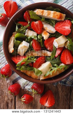 Salad With Strawberries, Grilled Chicken, Brie And Arugula Closeup. Vertical Top View