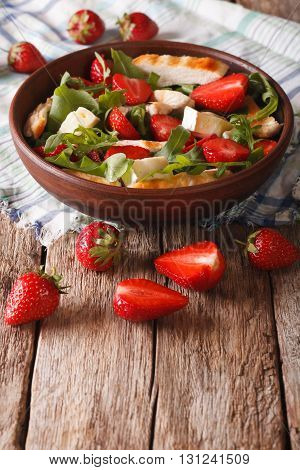 Dietary Salad With Strawberries, Grilled Chicken, Brie And Arugula Close-up. Vertical