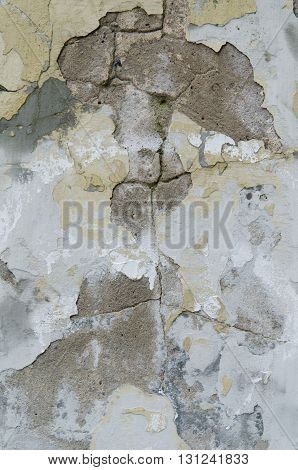 Texture of an old cement painted gray wall with cracks and holes
