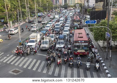 BANGKOK THAILAND - APR 29 : traffic jam on Ratchadapisek Road at Asoke junction on april 29 2016 thailand. traffic jam is one of worse issue of Bangkok