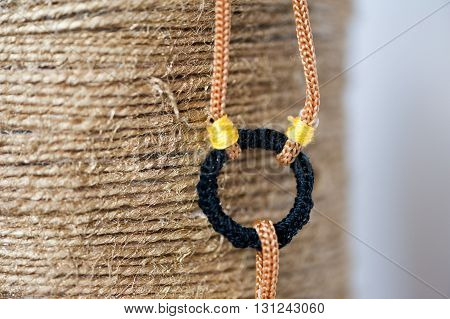 View of a crochet bracelet on a brown background