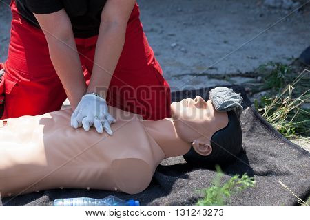 First aid training. Paramedic demonstrate Cardiopulmonary resuscitation (CPR) on the CPR dummy.