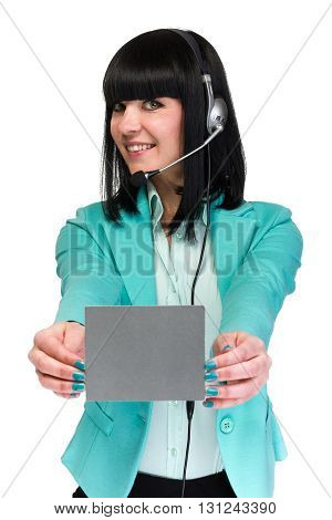 Pretty young call center worker wearing a headset and holding blank sign board