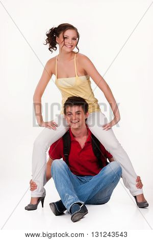 Young man and woman smiling on isolated background