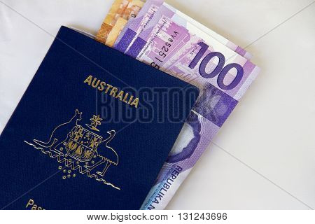 Philippine peso notes and an Australian passport.