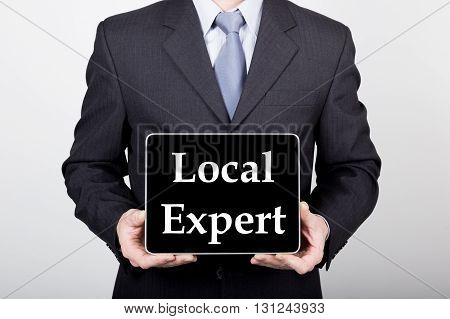 technology, internet and networking in business concept - businessman holding a tablet pc with local expert sign. Internet technologies in business.