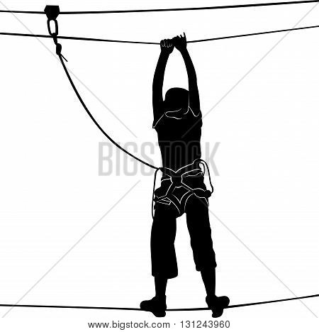 in adventure park rope ladder. Silhouette Adventure. Woman on cables in an adventure park on a difficult course