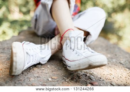View white female shoe and bright clothes for the summer holidays